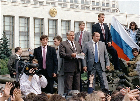 Russian President Boris Yeltsin speaks from atop a tank outside the government house in 199