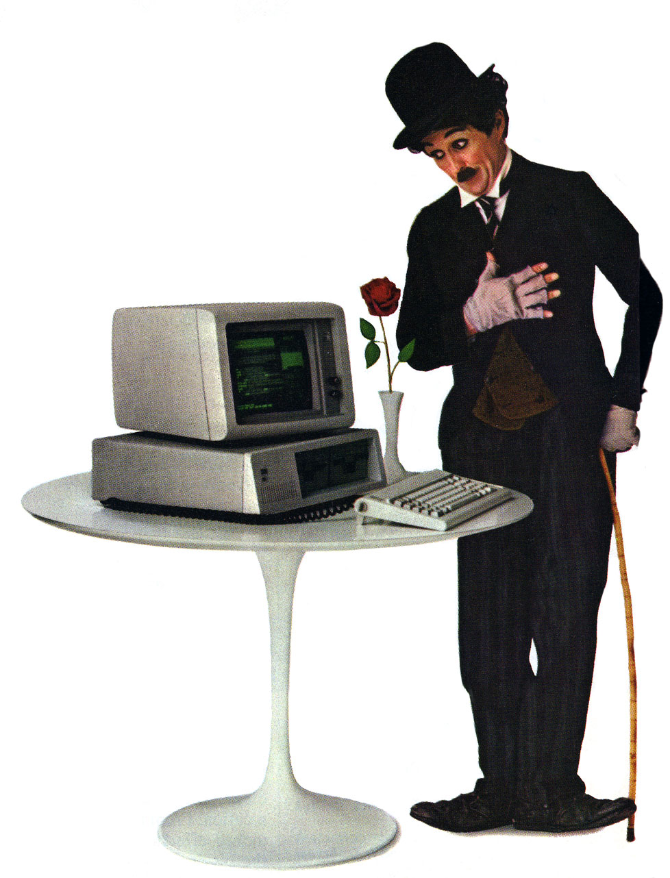 Photo of IBM PC advertisement with a Charlie Chaplin like person, rose and PC