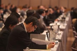 Delegates listen to Patrick Chovanec of Tsinghua University School of Economics and Management at the CFA Institute Asia Pacific Investment Conference