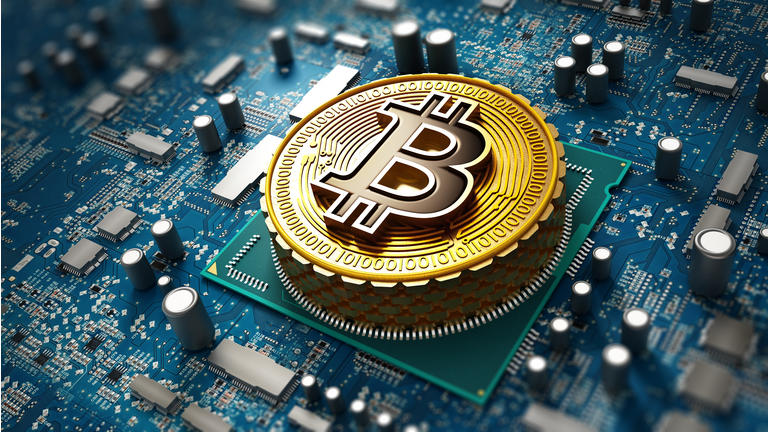 Crypto currency / Blockchain concept with coin on the motherboard