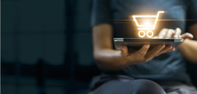 Online shopping and digital marketing concept, Woman using digital tablet with shopping cart icon on screen on dark background.