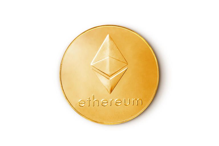 Baku, Azerbaijan - August 24, 2020: Ethereum coin cryptocurrency. Top view isolated on white white background.