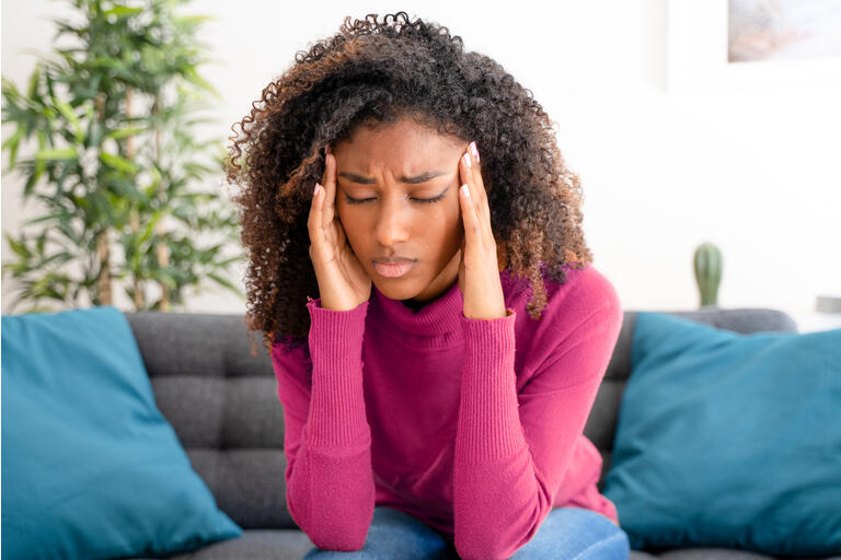 Young black woman suffering bad and strong headache