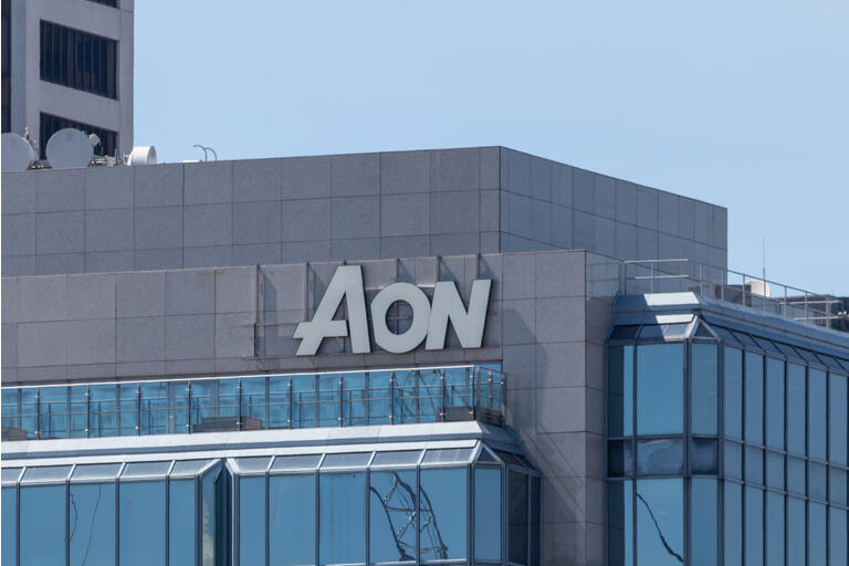 A Sign Atop of an AON Building and Headquarters in Downtown Vancouver, BC