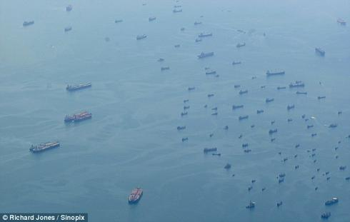 """""""ghost fleet of the recession"""" - hundreds of idle ships anchored off the straits of Singapore"""
