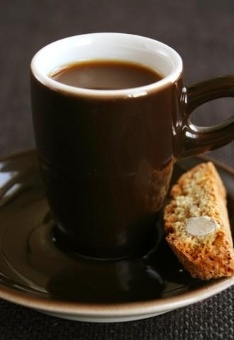 Cup of espresso and cookie