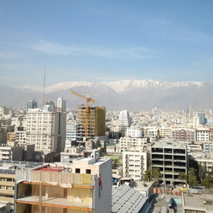 View over Tehran with snow covered mountains