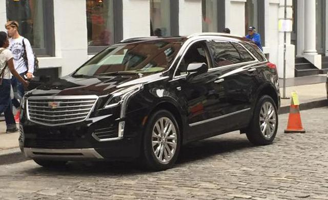 Gm S Cadillac Attacks Tesla With New Best Selling Suv Tesla