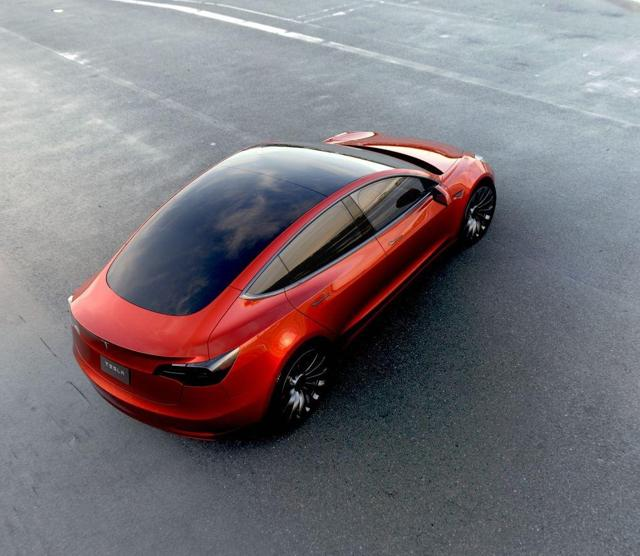 Red Tesla Model 3 from above-quarter - Tesla Motors