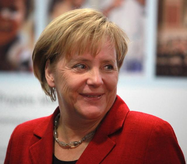 Merkel is happy, probably because of the giant budget surplus!