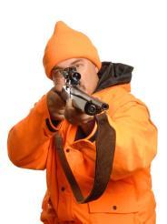 hunter pointing rifle in blaze orange gear