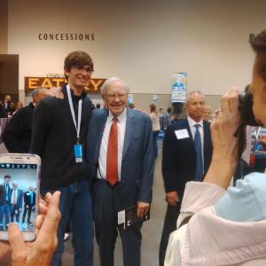 Buffett taking pictures with attendees Friday at the exhibition hall.