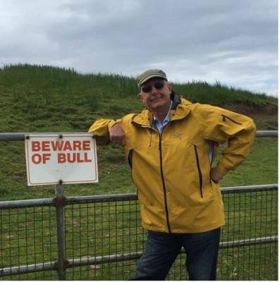 John with Beware of Bull Sign