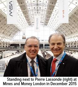 Frank Holmes standing next to Pierre Lassonde right at Mines and Money London in December 2015