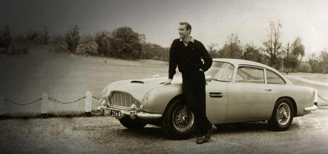"""James Bond (Sean Connery) and his Aston Martin DB5 from """"Goldfinger"""""""