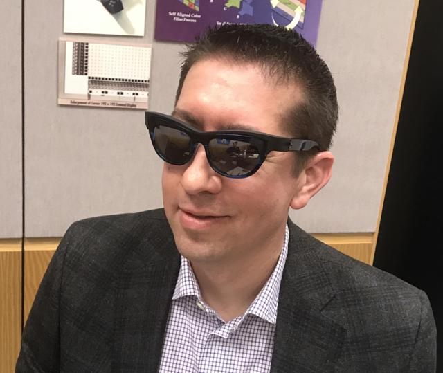 The author wearing custom smart glasses