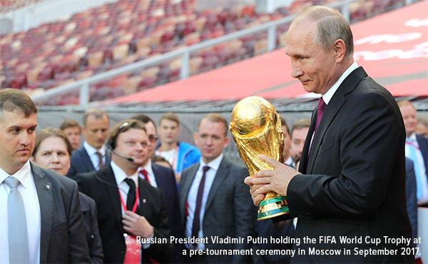 Russian president Vladimir Putin holding the FIFA world cup trophy at a pre tournament ceremony in Moscover in September 2017