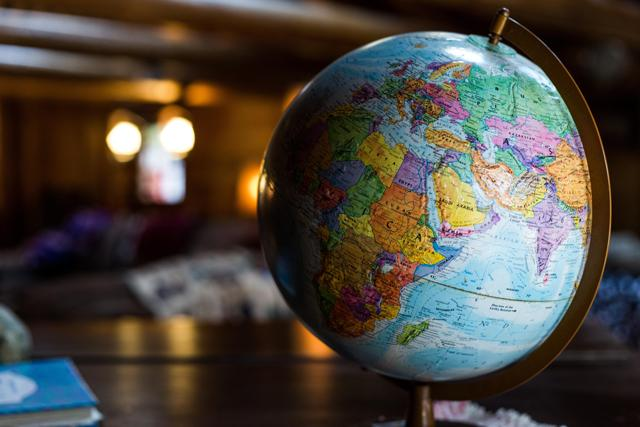 An image of a globe on a table
