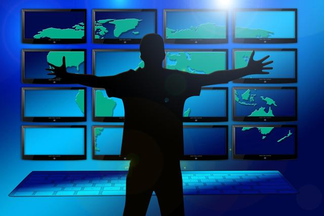 Man in front of video wall illustrates Zoom Video Communications success