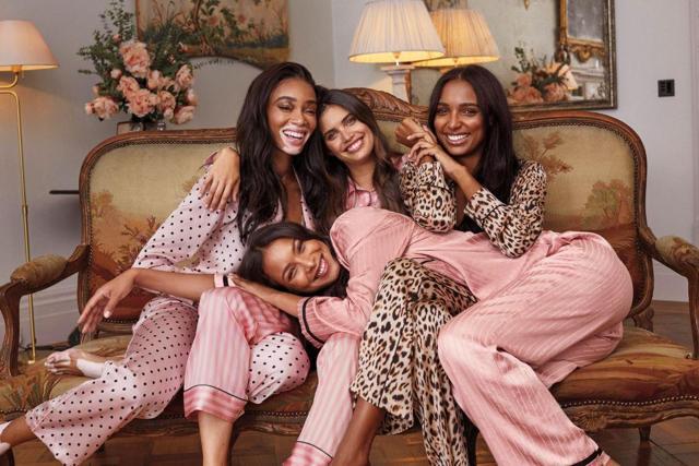 Four women modeling Victoria