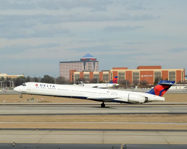 A Delta Air Lines MD-90 landing on a runway