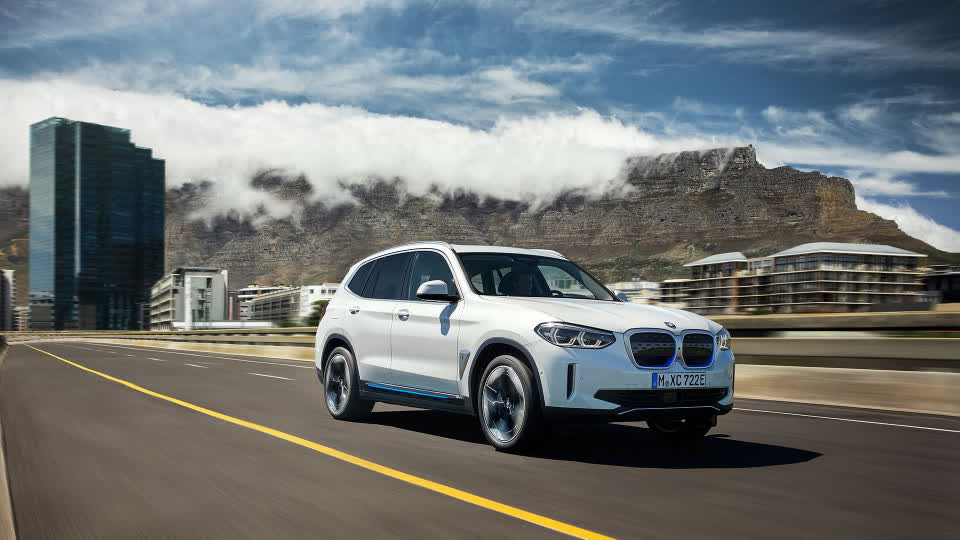 BMW iX3 front profile while driving